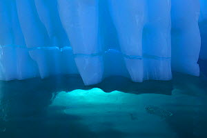 Iceberg detail with light coming through opening underwater, Antarctica, February - Tim Laman