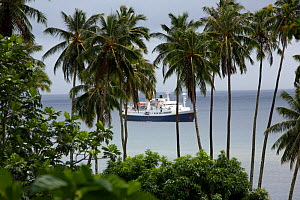 National Geographic ship, Endeavour, at anchor in Hatiheu Bay, Nuku Hiva, Marquesas Islands, French Polynesia, July 2006  -  Tim Laman