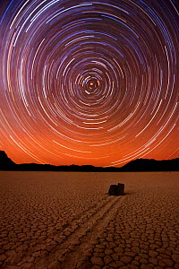 "Long exposure to capture star trails circling around the North Star, Polaris, at the ""Racetrack,"" a remote desert playa (dry lake bed) in Death Valley National Park, famous for its mysterious moving r...  -  Floris van Breugel"