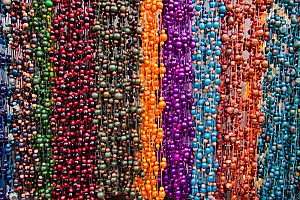 Handmade beaded necklaces for sale in a large famous Indian market in the town of Otavalo, Equador.  -  David Fleetham