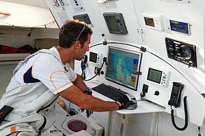 Skipper Armel le Cleac'h using satellite navigation on board Imoca open 60 ^Brit Air^ during qualification for Route du Rhum 2010, France, September 2010. - Benoit Stichelbaut