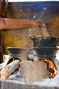 Woman cooking with wood efficient Bindi stove. Dry tropical forest of Colombia, South America  -  Lisa Hoffner