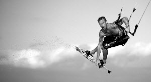 Kite-surfer Matthius Larsen performing stunt, Cape Town, South Africa, March 2010. Model released. - Charlie Dailey