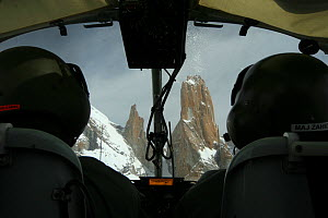 Rear view of pilots and Trango towers in the Karakoram Mountains, Himalayas, Pakistan, from Pakistani military helicopter, for BBC series Planet Earth. April 2005  -  Jeff Wilson