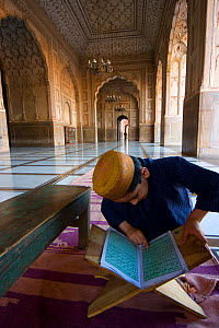 Boy studying Koran inside Mosque, Lahore, Pakistan, 2006  -  Jeff Wilson