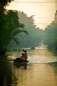 Woman in boat on Mekong Delta, Vietnam, January 2009. - Charlie Dailey