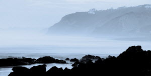 Barely visible house and coastline in mist. Biarritz, France, October 2010. - Charlie Dailey