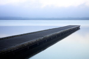 Jetty reflected in calm water. Biarritz, France, October 2010. - Charlie Dailey