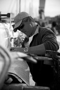 Man working, Palma boat yard, Mallorca, Spain, March 2008. Model released. - Charlie Dailey