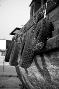 Tyres used as fenders on wooden boat, Palma boat yard, Mallorca, Spain, March 2008. - Charlie Dailey