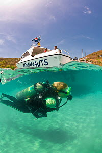 Split level view of scuba diver with PR Aquanauts boat in Grenada, Caribbean. May 2009. Property released and diver model released.  -  Michele Westmorland