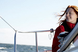 Young woman relaxing on board yacht.  Kerteminde, Denmark, September 2010. Model and property released. - Gary John Norman