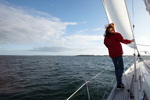Young woman on board yacht, Kerteminde, Denmark, September 2010. Model and property released. - Gary John Norman