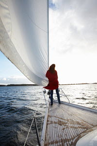 Young woman enjoying breeze on foredecks of yacht, Kerteminde, Denmark, September 2010. Model and property released. - Gary John Norman