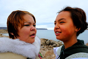 Double portrait of two young Inuit women singing Inuit songs, Qikiqtarjuaq village, Baffin Island, Nunavut, Canada, August 2010  -  Eric Baccega