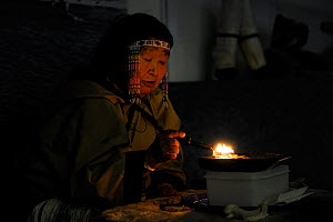 Portrait of Inuit chaman woman burning oil and chanting incantations, Pond Inlet, Baffin Island, Nunavut, Canada, August 2010  -  Eric Baccega