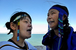 Two young Inuit women singing Inuit songs, wearing traditional beaded headbands, Pond Inlet village, Baffin Island, Nunavut, Canada, August 2010  -  Eric Baccega