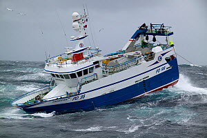 """Fishing vessel """"Harvester"""" heaving trawl wire onboard on the North Sea, September 2010. Property released. - Philip Stephen"""