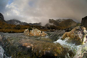 Mountain landscape, The Glyders, with view of flowing freshwater stream in foreground, showing water turbulence around rocks, Snowdonia NP, Gwynedd, Wales, UK. December 2009. - Graham Eaton