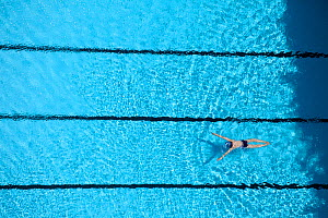 Aerial view of woman swimming in pool in Guangzhou, China.  -  David Fleetham