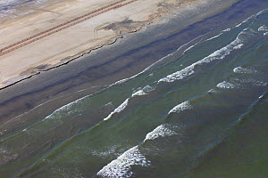 Aerial view of an oil stained beach, contaminated by the BP Deepwater Horizon oil leak in the Gulf of Mexico. Grand Isle, Jefferson Parish, Louisiana, USA, July 2010. - Gerrit Vyn