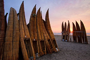 Upturned canoes (caballitos) owned by the Fishermen of Totora, on Pimentel beach at sunset. Chiclayo. Peru November 2009 - Juan Manuel Borrero