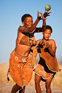 Kalahari bushmen, women playing with melon, Central Kalahari Desert, Botswana, August 2008  -  Christophe Courteau