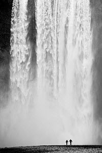 Two people silhouetted in front of Skogafoss waterfall in southern Iceland, June 2009 - Guy Edwardes