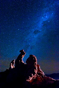 Eroded rock formation known as the 'Tres Maries', in the Valle de la Luna. One million year old composition of gravel, clay, salt, gems and quartz, against The Milky Way and Southern Cross in the nigh...  -  Jack Dykinga
