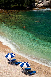 Aerial view of swimmer off Pipitos beach, northern Corfu, Greece, June 2010.  -  Toby Roxburgh