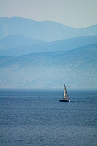 Yacht sailing in the straits between northern Corfu, Greece, and Albania, June 2010. - Toby Roxburgh