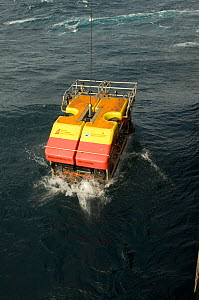 Launching ROV Isis (remotely operated vehicle) into the sea from James Cook research vessel over the mid Atlantic ridge, June 2010 - David Shale