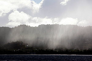 Rain shower across Sandy Island, the Grenadines, Caribbean, January 2010.  -  Billy Black