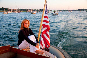 """Woman relaxing stern of luxury motorboat """"Aphrodite"""". Newport, Rhode Island, USA, July 2010. Model and Property released.  -  Billy Black"""
