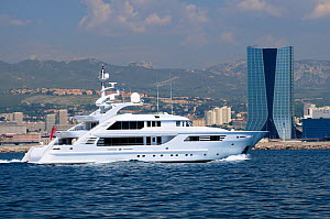 """Luxury motoryacht """"Ocean Victory II"""" passing the CMA CGM Tower as it arrives in Marseille. France, May 2010. - Nick Upton"""