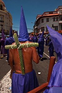 Cucuruchos carrying a cross made from prickly cactus, during the Good Friday Procession commemorating the Passion and Death of Jesus Christ, Quito, Ecuador, April 2010 - Pete Oxford