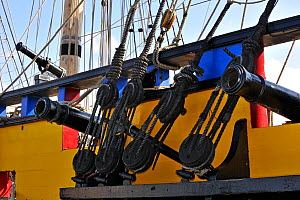 """Wooden blocks and cannons on board the """"Grand Turk / Etoile du Roy"""", a three-masted sixth-rate frigate built in 1996 as a replica of HMS Blandford, built in 1741, Saint Malo, Brittany, France, Septemb... - Philippe Clement"""