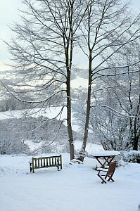Garden furniture and outlook view towards Box village in winter snow, Wiltshire, UK, December 2010 - Nick Upton