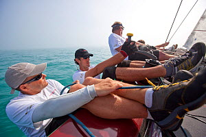 """Crew hiking-out on board RC44 """"Ironbound"""" during Key West Race Week. Florida, USA, January 2011. All non-editorial uses must be cleared individually. - Billy Black"""