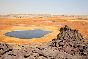 Black mountain area at Dallol, 1926 crater (Black lake)., Afar Region, Northern Ethiopia.Colours of the geothermal area derive from ferrous chloride, iron hydroxide (both greenish white) ferric chlori...  -  Visuals Unlimited