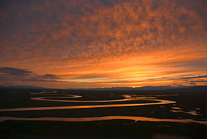 "Sunset over winding river in Bayinbuluke Swan Lake Nature Reserve, Xinjiang, China. Picture taken during filming of BBC ""Wild China"" TV Series, June 2006.  -  Barrie Britton"