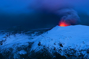 Ash plume and lava eruption from the Eyjafjallajokull volcano at night, Iceland, April 2010  -  Orsolya Haarberg
