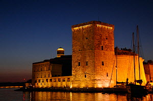 17th Century Fort St. Jean at the entrance to Marseille harbour, illuminated at night. France, May 2010.  -  Nick Upton