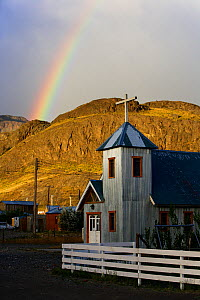 Rainbow above church in the village of El Chalten, Los Glaciares National Park, Patagonia, Argentina, January 2006  -  Oriol Alamany