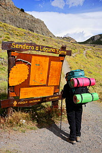 Hiker studies map on signpost at the beginning of the Laguna Tower trail, El Chalten, Los Glaciares National Park, Patagonia, Argentina, January 2006  -  Oriol Alamany