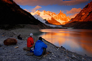 Mountaineers watching the sunrise over Cerro Torre (3102 m), Los Glaciares National Park, Andes, Patagonia, Argentina, January 2006  -  Oriol Alamany