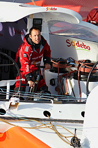 """Skipper Thomas Coville on board maxi trimaran """"Sodebo"""", during singlehanded circumnavigation record attempt. Brest, France, January 2011. All non-editorial uses must be cleared individually. - Benoit Stichelbaut"""