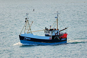 """Large crab boat """"Trevose"""" in the Camel Estuary, returning to harbour at Padstow, Cornwall, UK, April 2010. - Nick Upton"""