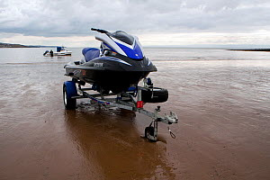 Jetski on a beach ready for launching. Wales, March 2010. - Toby Roxburgh