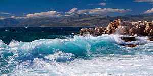 Waves breaking onto rocky shore on the northeast coast of Corfu, with the Albanian coast beyond. Corfu, Greece, June 2010. - Toby Roxburgh